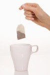 Hand holding tea bag